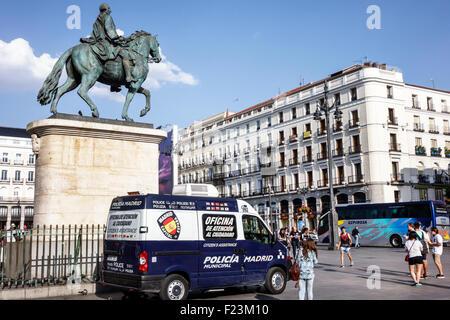 Madrid Spain Europe Spanish Centro Plaza de la Puerta del Sol equestrian statue King Carlos III police van - Stock Photo