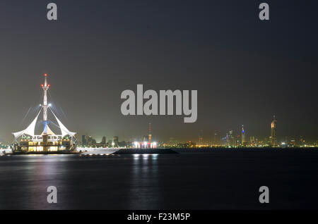 Marina Waves with Kuwait City skyline in the distance from Ras el Salmyia. - Stock Photo