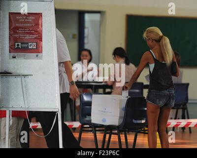 Singapore. 11th Sep, 2015. Singaporeans vote at a polling station at Singapore's Toa Payoh, Sept. 11, 2015. Singaporeans - Stock Photo