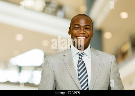 portrait of cheerful African business man in modern office - Stock Photo