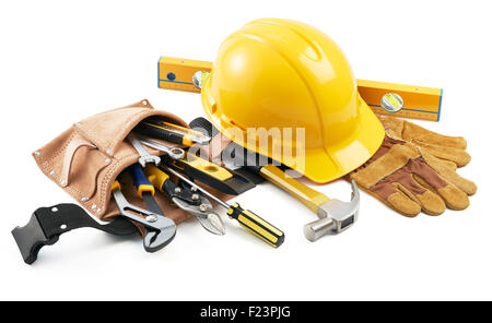 Workbench with helmet, pliers, hammer, gloves,ruler and other tools in white background - Stock Photo