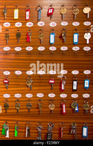 Retro rey board with room keys in motel reception. - Stock Photo
