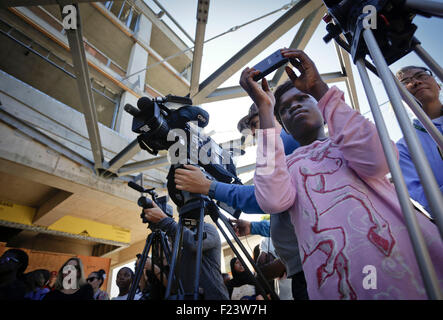 Vancouver, Canada. 10th Sep, 2015. A refugee immigrant takes photos during a visit to the construction site of a - Stock Photo
