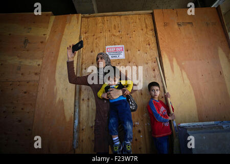 Vancouver, Canada. 10th Sep, 2015. A refugee immigrant from Syria takes photos of the construction site of the new - Stock Photo