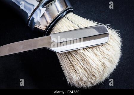 razor and shaving brush - Stock Photo