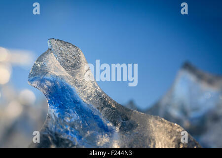 Ice formations in an iceberg at the beach near Jokulsarlon. South Iceland. - Stock Photo