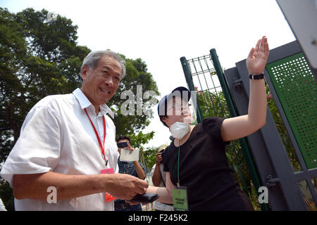 Singapore. 11th Sep, 2015. Singapore's Defence Minister Ng Eng Hen (L) arrives to vote at the Alexandra Primary - Stock Photo