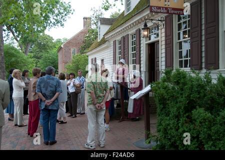 Costumed interpreters educate visitors at Colonial Williamsburg, , a living history museum, Williamsburg, VA - Stock Photo