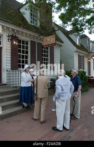 Costumed interpreters educate visitors at Colonial Williamsburg, a living history museum, Williamsburg, VA - Stock Photo
