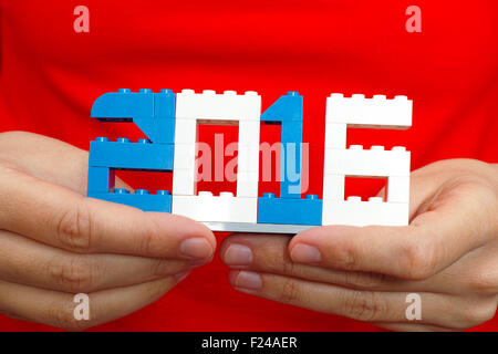 2016 made from plastic blocks in woman hands. New year concept. - Stock Photo