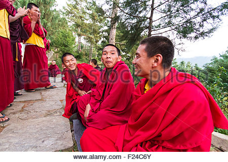 Bhutanese Buddhist monks engage in philosophical debates in the courtyard of a monastery in Bumthang, Bhutan - Stock Photo