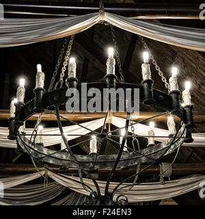 Interior of old pirate ship black and white image stock photo black and white image round iron chandelier in an old tavern stock photo mozeypictures Choice Image