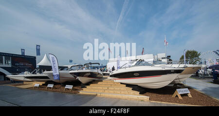 Southampton, UK. 11th September 2015. Southampton Boat Show 2015. The byliner stand with an impressive fan of speedboats. - Stock Photo