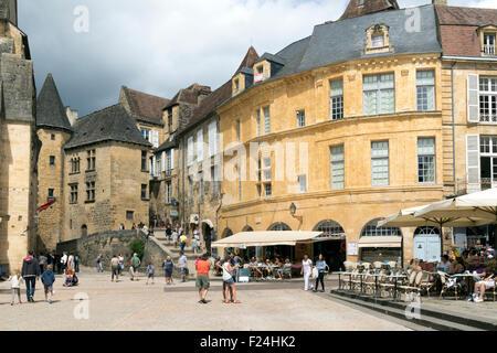 Tourists enjoying La Place de la Liberte in Sarlat France in thundery weather - Stock Photo