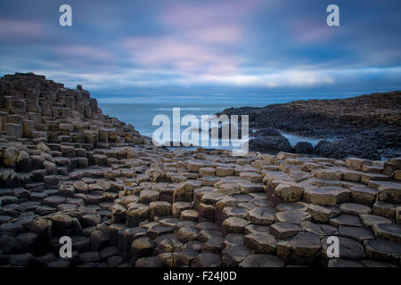 Twilight over the Giant's Causeway along the northern coast, County Antrim, Northern Ireland, UK - Stock Photo
