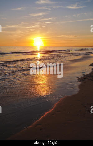 Beach during summertime at the end of the day. Sunset in Algarve, Portugal - Stock Photo