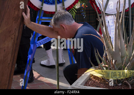 Los Angeles, California, USA. 11th Sep, 2015. A man reflects at the 9/11 Remembrance Ceremony in Los Angeles. Credit: - Stock Photo