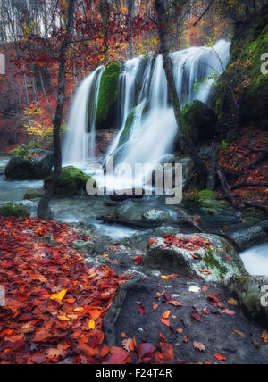 Beautiful waterfall in autumn forest in crimean mountains at sunset. Silver Stream Waterfall in Grand Canyon Of - Stock Photo