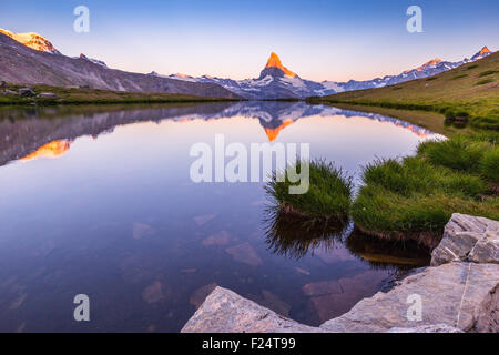 Sunrise on Matterhorn (Cervino) mountain peak. View from Lake Stellisee, Alpine landscape, Zermatt, Swiss Alps. - Stock Photo