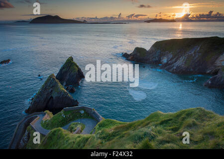 Sunset over windy road to Dunquin Harbor, Dunquin, County Kerry, Republic of Ireland - Stock Photo