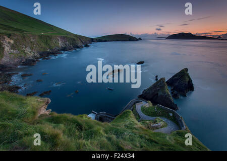 Twilight over windy road to Dunquin Harbor, Dunquin, County Kerry, Republic of Ireland - Stock Photo