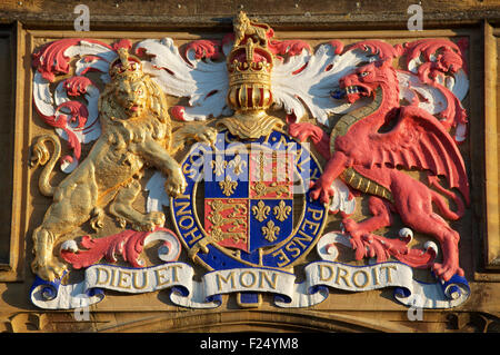 The Royal Coat of Arms of King Edward 6th above the entrance to Sherborne School, which was re-founded in his reign. - Stock Photo