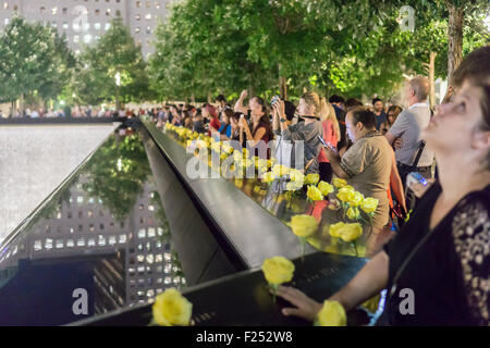 New York, New York, USA. 11th Sep, 2015. People gather at the 9/11 Memorial in New York on September 11, 2015 for - Stock Photo