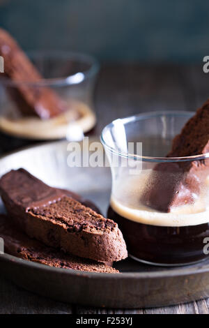 Chocolate biscotti cookies dipped in chocolate with a cup of coffee - Stock Photo