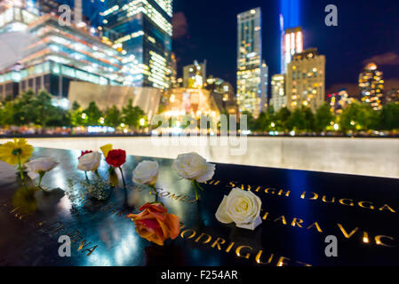 New York, NY - September 11th 2015 - Flowers surround the reflecting pools at the 911 Memorial and Museum on the - Stock Photo