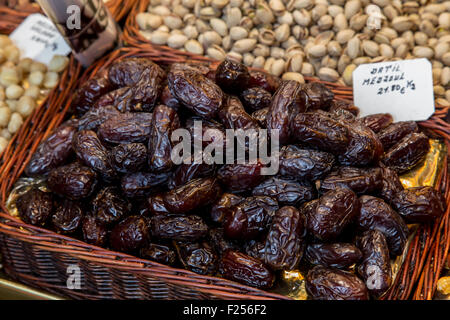 Fresh dates in a market, detail of a healthy lifestyle food, fruit - Stock Photo