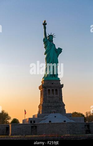 United States, New York, the Statue of Liberty at sunset - Stock Photo