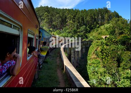 Sri Lanka, Uva Province, train on the railway track that goes through the tea growing hill country between Badulla - Stock Photo