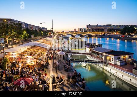 France, Paris, Quai Franτois Mauriac, in summer beach restaurants settled along the Seine, in the foreground Vagalame - Stock Photo
