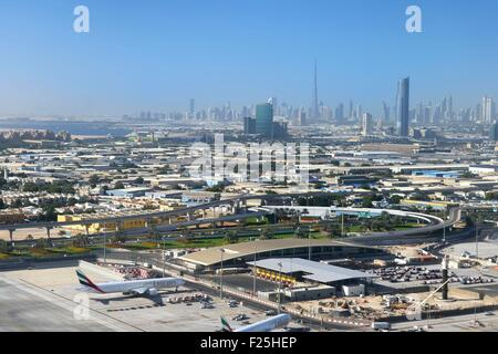 United Arab Emirates, Dubai, Dubai International Airport and the city center in the background (aerial view) - Stock Photo