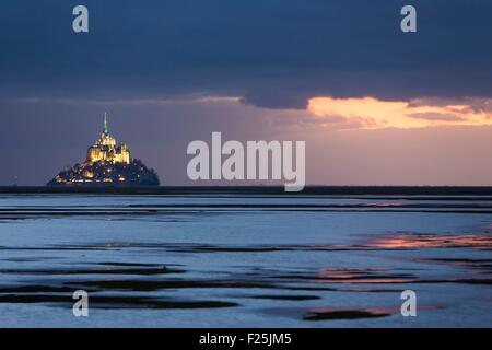 France, Manche, Mont Saint Michel listed as World Heritage by UNESCO, Mont Saint Michel from the littoral at sunset - Stock Photo