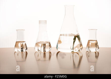Measuring glasses on a table of a chemical laboratory - Stock Photo