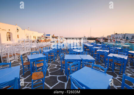 Restaurants in the port of Naousa village on Paros island, Greece - Stock Photo