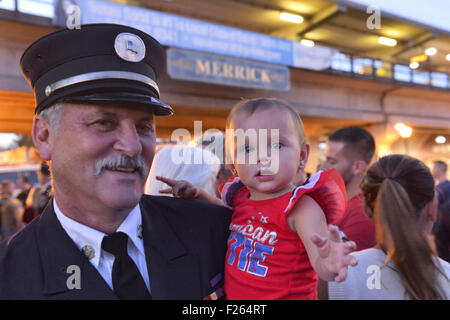 Merrick, New York, USA. 11th Sep, 2015. RILEY E. GIES, one-year-old granddaughter of Fire Chief Ronnie E Gies who - Stock Photo