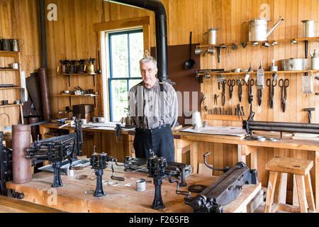 Ouellet Tinsmith Shop (circa 1905) at Village Historique Acadien, Caraquet, New Brunswick, Canada. - Stock Photo