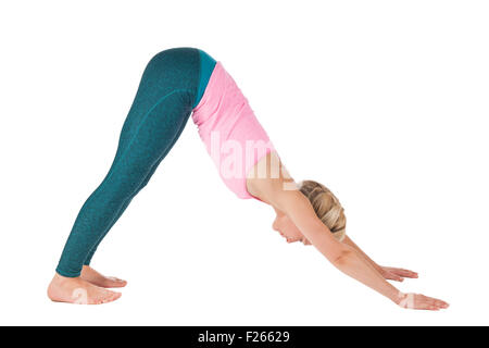 Yoga series picture: Full lateral profile view of a middle-aged blonde woman doing yoga exercise dog (Downward Facing - Stock Photo
