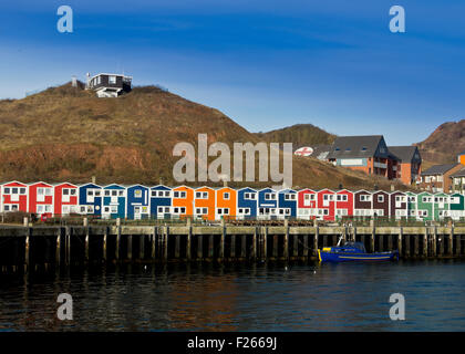 Traditional harbor houses at the fishermen's wharf of Helgoland Island in the North Sea (Germany) - Stock Photo