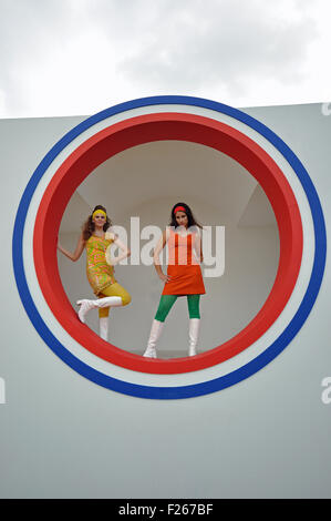 Goodwood Revival. Girls in swinging sixties period attire - Stock Photo