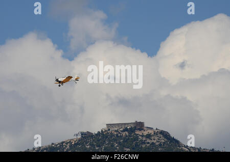Athens, Greece. 12th Sep, 2015. A HAF PZL M18 Dromader flies over the spectators during the first day of Athens - Stock Photo