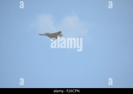 Athens, Greece. 12th Sep, 2015. A HAF Mirage 2000-5 airplane flies over the spectators. 1st Day of Athens Flying - Stock Photo