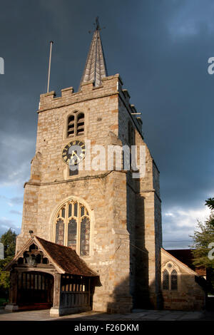 11th century Church of St Lawrence in the evening light, Chobham village, Surrey - Stock Photo