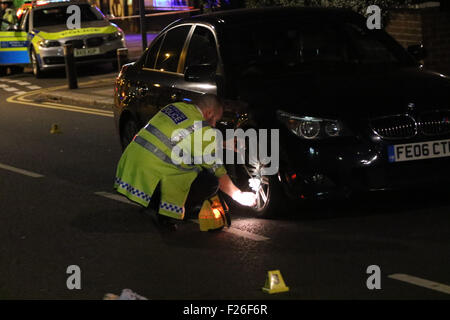 London, UK. 13th September, 2015. Police close Conley Hatch Lane between Greenham Road & Wilton Road to allow traffic - Stock Photo