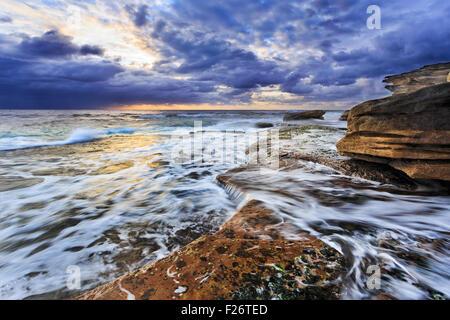 Picturesque pacific coastline at sunrise near Maroubra beach in Sydney - Stock Photo