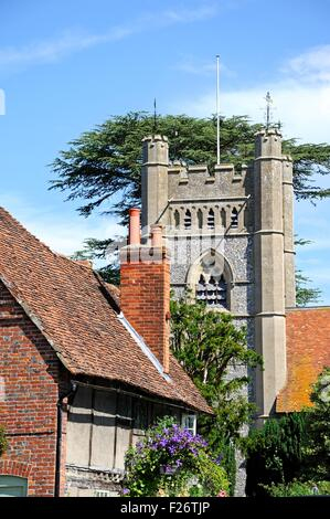 Pretty cottage with the Church of St Mary the Virgin to the rear, Hambledon, Oxfordshire, England, UK, Western Europe. - Stock Photo