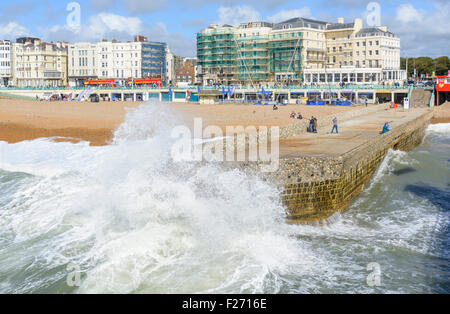 Brighton groyne. Waves splashing over the old groyne at the seafront in Brighton, East Sussex, England, UK. Brighton - Stock Photo