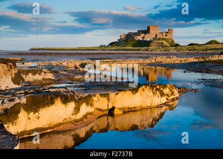 Bamburgh Castle on the north east coast of Northumberland. Once the residence of the Kings of Northumbria. Stock Photo